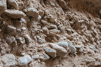 Photo: The walls of Little Slot Canyon are adobe with embedded stones; PEEC Slot canyons hike with Doug Scott