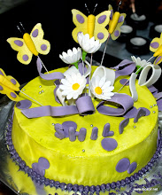 Photo: Yellow and Purple Butterfly on Cream Cake