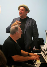 Photo: Gary Glazner recites a poem with Scott accompanying him on the piano