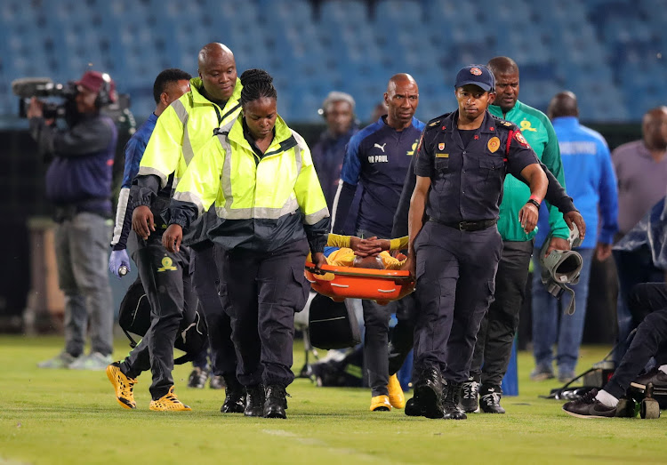 Thapelo Morena of Mamelodi Sundowns leaving the field after being injured during the 2020 Nedbank Cup match between Mamelodi Sundowns and Supersport United at Loftus Versfeld Stadium, Pretoria on 08 February 2020.