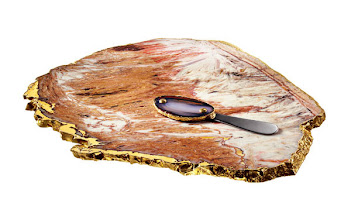 Photo: RABLABS Exclusively ours. Calcedonia cheese board and stainless steel cheese knife with agate handle. Both with 24k gold edge detail. $450. Imported. Seventh Floor. 212 872 2686