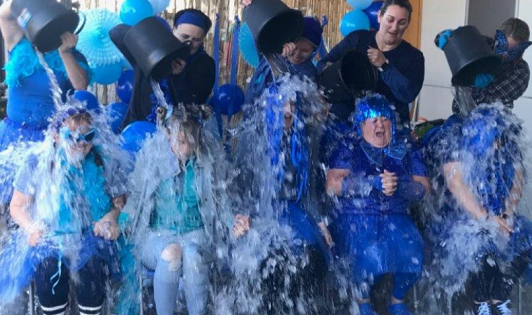 Early Childhood Teacher Susie Lissa was a good sport as she allowed children to tip icy water on her at Glendonald Preschool at Churchill
