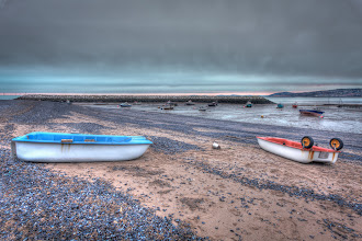 Photo: The beach at Rhos on sea shows a bed of mussels at low tide.