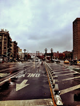 Photo: The beginning of Hurricane Sandy on Monday morning - New York City   This is a view looking down Delancey Street towards the Williamsburg Bridge on the Lower East Side of Manhattan. Usually there are tons of cars and traffic at this time of morning coming off and going on to the bridge. I assume the bridges will be shut down at some point this afternoon. For now, a few cars are passing over the bridge. The winds are kicking up and the rain is a light mist.  Just went out to see if anything was open (it was: Dunkin Donuts on Delancey!). It's quite a scene out there already though. In my apartment now waiting for the worst to hit this afternoon.  In case you missed my earlier post, you can catch me on my Twitter: http://twitter.com/Vivnsect  -  mainly until the middle of this week unless I have to go out for some completely insane reason (hoping the power stays on!)    New York photography  - Hurricane Sandy, Lower East Side, New York City.   You can view this post over at my site here:  http://nythroughthelens.com/post/34566482707/looking-down-delancey-street-towards-the  -  Tags: #hurricanesandy   #hurricanesandynyc   #sandy   #frankenstorm   #nyc   #photography   #newyorkcity   #newyorkcityphotography   #lowereastside   #williamsburgbridge   #storm   #mobilemonday   #mobilephotography   #iphoneography   #iphonography     #moodymonday