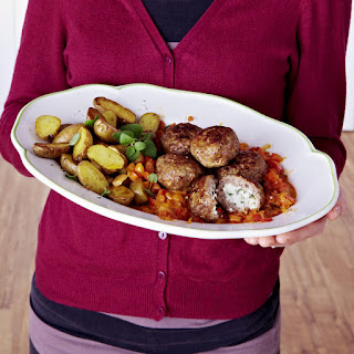 Stuffed Meatballs served with Potatoes and Pepper Sauce.