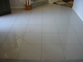 Photo: 20x20 high gloss porcelain at entery way W/ 1/8 wide grout line