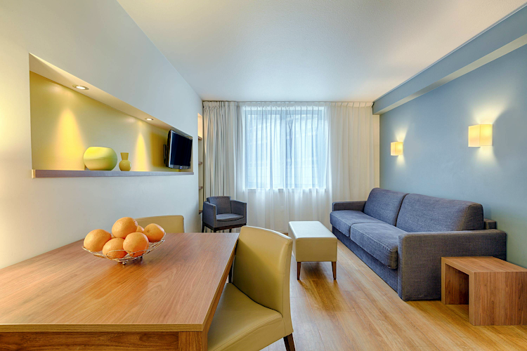 Comfy living area at Citadines Place d'Italie Paris