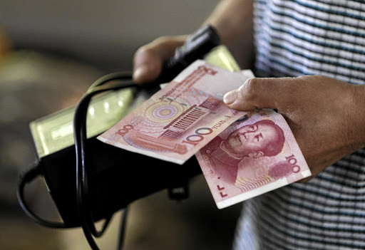 Desperate measures: The People's Bank of China's new measures, which see a steeply cut cash reserves banks must hold, come into effect on October 15. They are aimed at boosting the economy. Reuters