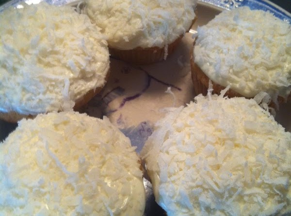 Mix coconut flavor in with your fave vanilla icing till desired taste. Frost cupcakes...