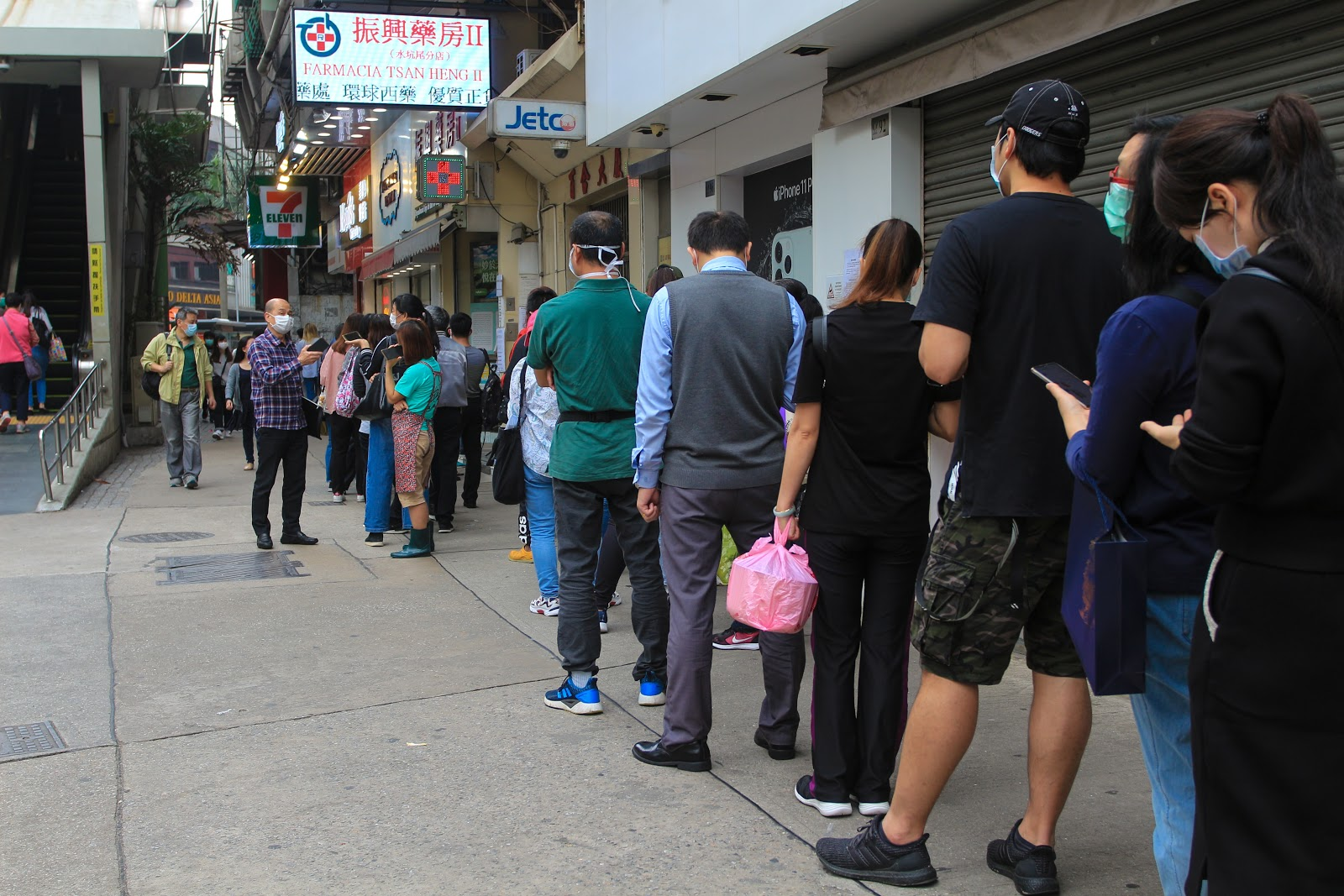 People in line wearing wholesale masks