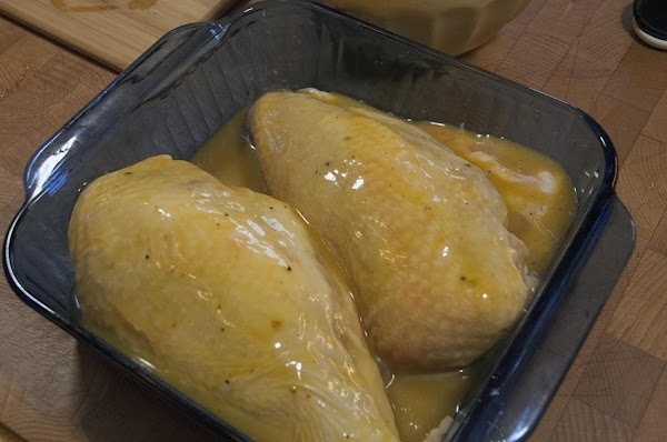 Pour the Dijon/honey sauce evenly over the chicken breasts.