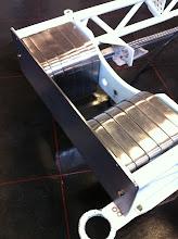 Photo: Ook worden de nodige aanpassingen aan het frame gemaakt zo hier de gewichten aan de voorzijde met tevens een dikkere front plaat.