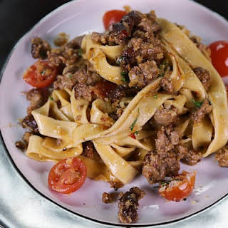 Creamy Fettuccine with Spicy Sausage and Cherry Tomatoes.