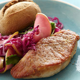 Pork Tenderloin Steaks with Wilted Cabbage and Apples.