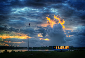 Photo: The Countdown Clock at NASA at Sunrise...    This is the famous countdown clock. Scott Kublin and I woke up before 5 AM to start setting up our remote cameras. One of them Leo Laporte Fed-exed to me overnight so we could have time to set it up… we put those inside the blast zone and set them up to automatically fire at the launch. We made a behind-the-scenes video to show how everything was done… it will be edited and shared soon… but, in the meantime, here is what I saw first thing in the morning upon arrival to NASA.  more photos at http://www.StuckInCustoms.com from Trey Ratcliff