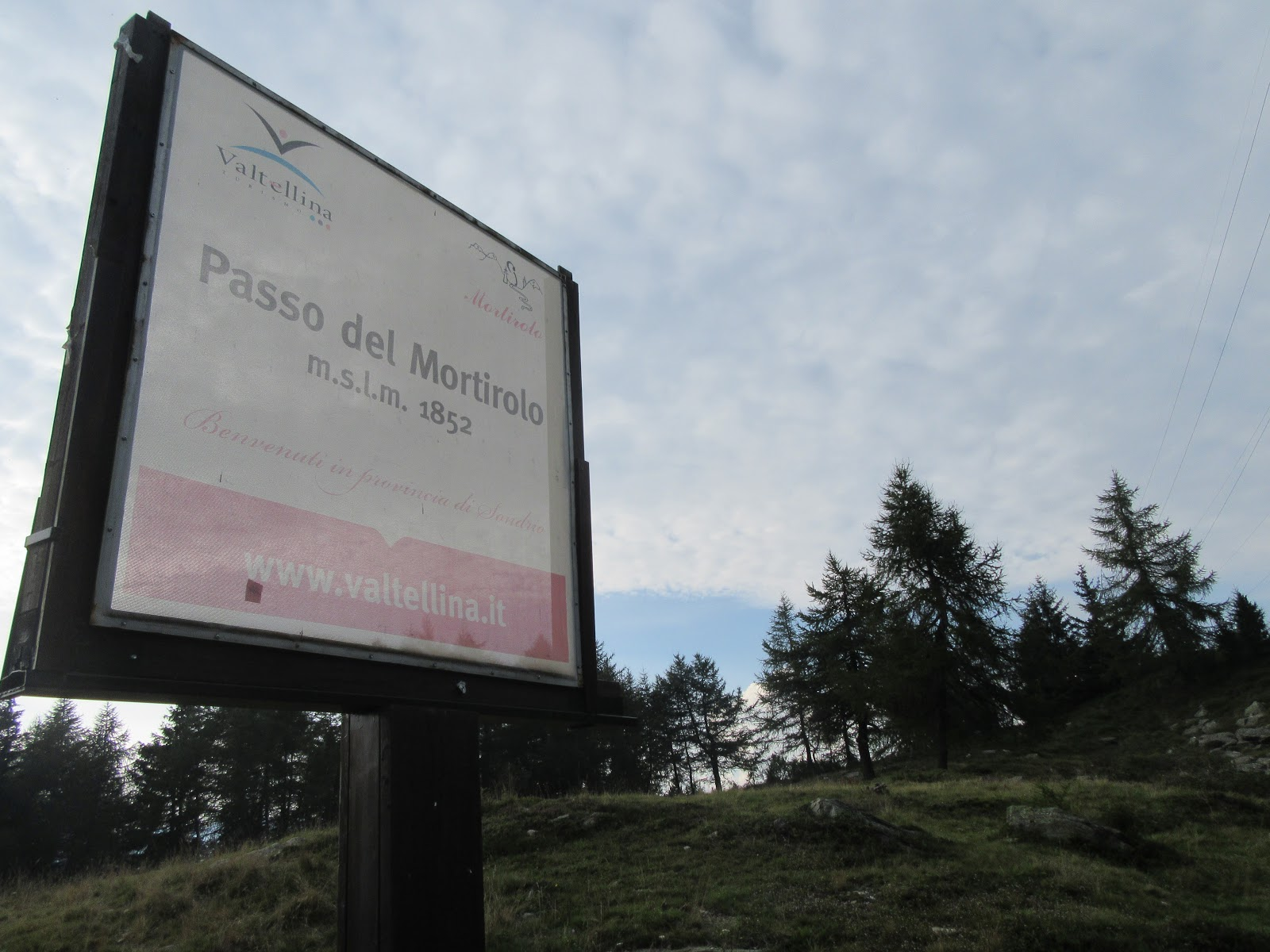 Bike climb of Passo del Mortirolo from Grossio - sign at the top of the climb