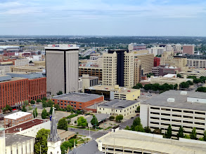 Photo: View of downtown Lincoln, with the UNL campus and stadium beyond.