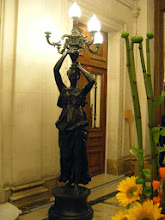 Photo: I believe that a light-bearing statue such as this is called a torchiere.