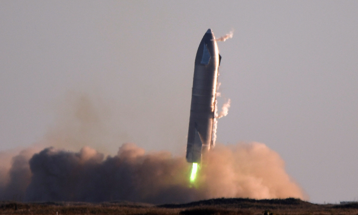 SpaceX's first super heavy-lift Starship SN8 rocket during a return-landing attempt after it launched from their facility on a test flight in Boca Chica, Texas US on December 9 2020.