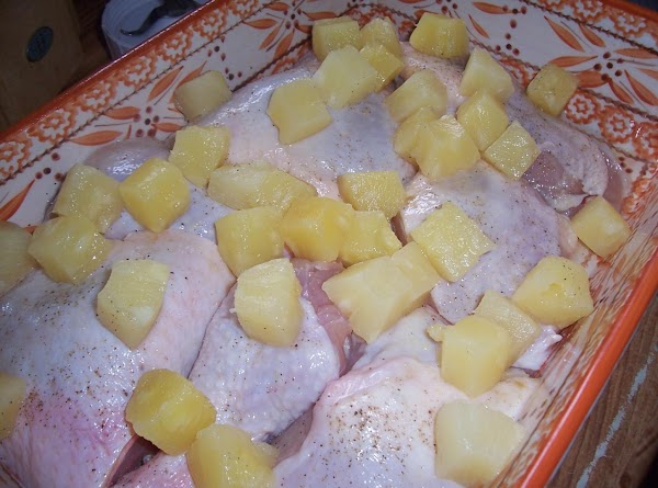 Drain pineapple chunks reserving juice for another application. Spread pineapple chunks over chicken.