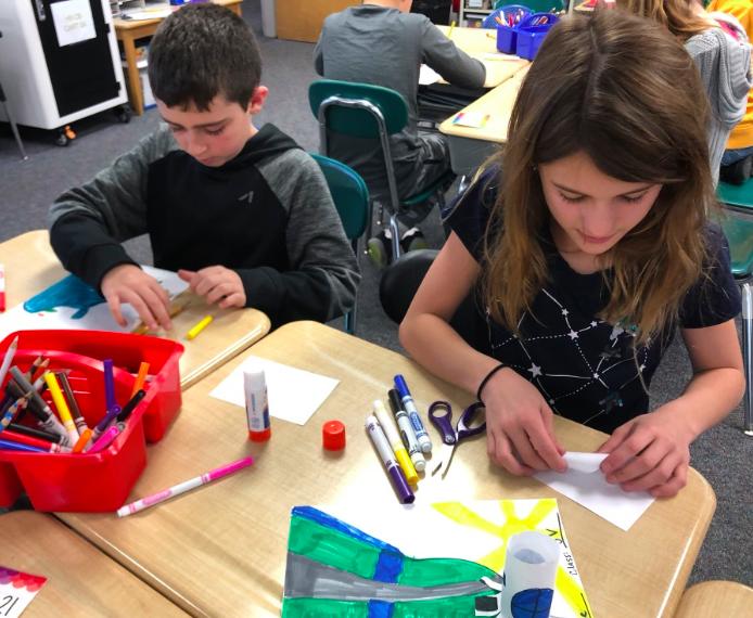 5th graders making artwork