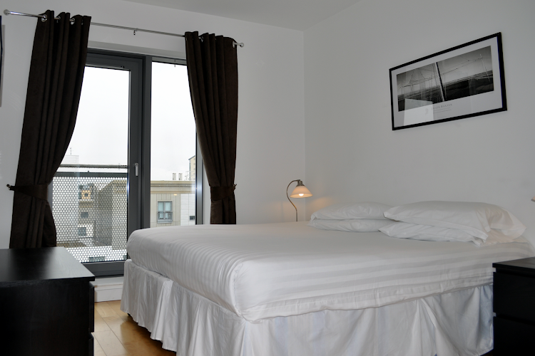 Cosy bed at Ocean Serviced Apartments