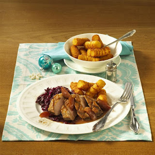 Pan-Fried Duck Breast with Potato Croquettes and Plum Sauce.