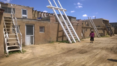 Photo: August 11-The huge ladders led up to the kiva which the men could descend into from the roof.