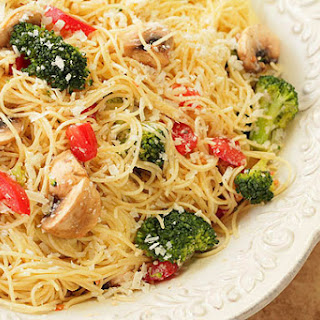 Pasta with Broccoli, Mushrooms, Tomatoes and Parmesan Cheese.