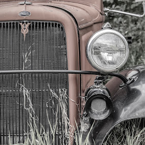 Resurrection by George Kremer - Transportation Automobiles ( old, truck, fine art, ford, rusted, rust, close-up, fender, grass, radiator, vintage, antique, muted, headlight, grill )