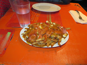 Photo: Poutine at La Banquise. One regular was plenty for two