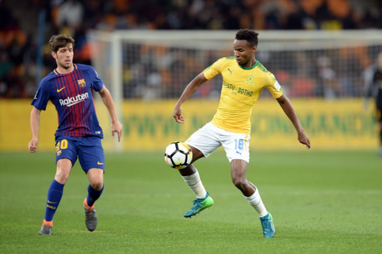 Barcelona's Sergi Roberto challenge and Themba Zwane of Mamelodi Sundowns during the International Club Friendly match between Mamelodi Sundowns and Barcelona FC at FNB Stadium on May 16, 2018 in Johannesburg, South Africa.