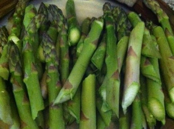 In a large kettle boil water and cook asparagus aldente. Do not over cook....