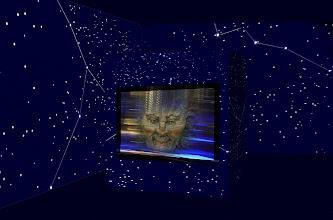 """Photo: Fotoprojekt Motion Polarity © Franz Immoos Amsterdam 2014 Bei den Arbeiten werden Abbildungen von Masken mit einem bewegten Hintergrund als """"Fotocollagen"""" miteinander kombiniert. Das Projekt besteht aus diesen Maskenbilder die sich in langsamer Folge in einem """"Slow motion Film"""" überlagern. Dieser Slow motion Film wird mit einem Beamer oder einem Videoscreen wiedergegeben. Im abgedunkelten Raum werden Sternenbilder projiziert. Der Ton wird verzerrt wiedergegen."""