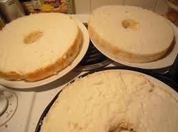 Stack cake layers on plate, spreading pudding mixture between layers and on top of...