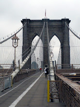 "Photo: Approaching the first set of Gothic arches that support the suspension cables on the western side of the Brooklyn Bridge (1869 and 1883).  ""The most noticeable feature of the Brooklyn Bridge are the two masonry towers to which the many cables are attached. The towers with large gothic arches are 276 ft tall (84 meters), at the time making them some of the tallest landmarks in New York. [John] Roebling claimed that the monumental towers would make  the bridge a historic monument. He was proven right when the bridge officially became a national monument in 1964."" http://www.aviewoncities.com/nyc/brooklynbridge.htm"