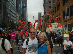 """Photo: Roger & Rae in front of the Seattle contingent. """"Protect our Salish Sea."""""""