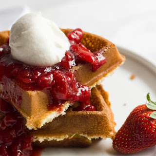 Waffles with Strawberry Syrup and Homemade Whipped Cream.