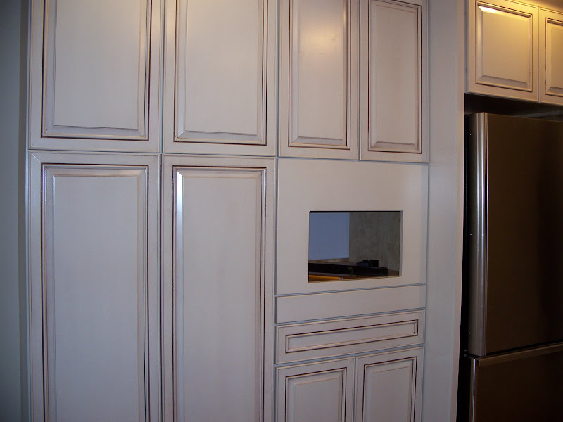 Can anyone show me creamy or ivory cabinets with glaze?