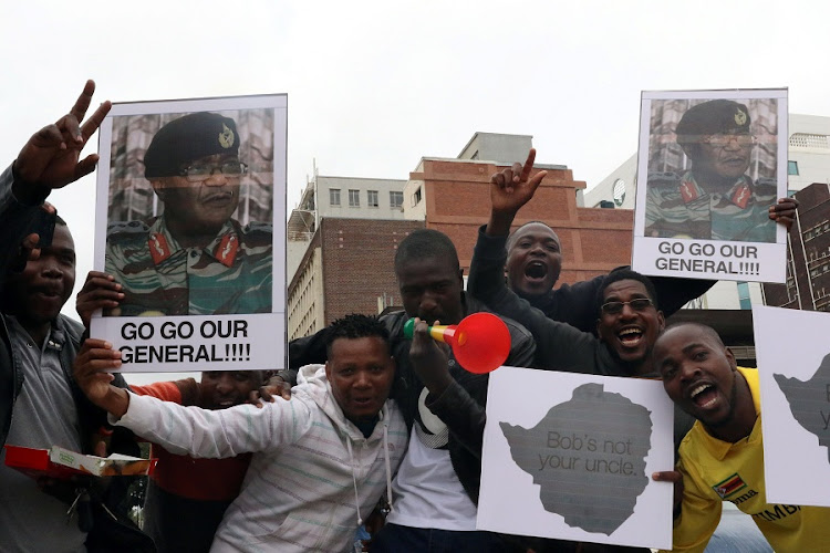 Protesters gather calling for Zimbabwe President Robert Mugabe to step down, in Harare, Zimbabwe. Picture: REUTERS/PHILIMON BULAWAYO