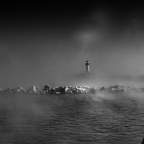 The Call to Port by Glen Sande - Black & White Landscapes ( winter, black and white, sea smoke, lighthouse, lake superior, ice formations, glen sande )