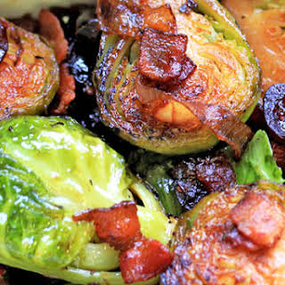 White Wine Braised Brussel Sprouts with Bacon and Cranberries.
