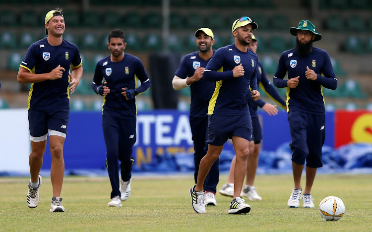 South Africa's Jean-Paul Duminy, Aiden Markram, Keshav Maharaj, Tabraiz Shamsi and Hashim Amla play soccer while running during a practice session ahead of their second One Day International (ODI) cricket match against Sri Lanka on July 31 2018.