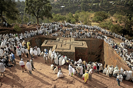 Rock of ages: Ethiopian Orthodox Christian pilgrims attend a prayer session at the monolithic Orthodox church ahead of Ethiopian Christmas in Lalibela. These churches, hewn out of solid rock, are also popular tourist attractions in a country that often battles natural and political challenges. Picture: REUTERS