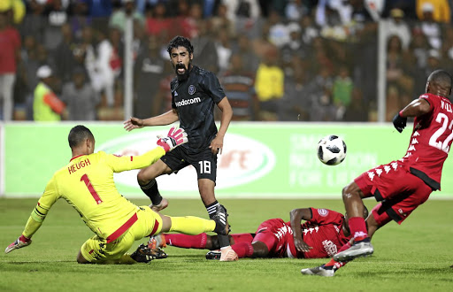 Abbubaker Mobara of Pirates avoids challenges by Marlon Heugh and Ricardo Williams of Highlands Park.