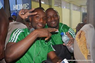 Photo: Mohamed 'Medo' Kamara and Mustapha 'Haji' Bangura celebrate on the team bus following their victory against Equatorial Guinea [Leone Stars Vs. Equatorial Guinea, 7 Sept 2013 (Pic: Darren McKinstry)]