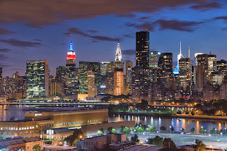 """Photo: Manhattan Skyline  Here's a shot of the skyline taken from Queens with the Empire State Building (which I still need to go to the top!) and the Chrysler building (which is one of my absolute favorite buildings in New York City!).  Question for you- I noticed that a lot of posts have a headline and then the option to """"read more"""" instead of just a long paragraph of text showing. Is there a shortcut or sneaky trick I'm missing on how to do this?"""