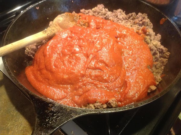 Return cooked meat back into skillet, and add the pasta sauce, and all of...