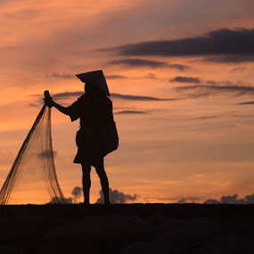 Morning Act by Yande Ardana - People Portraits of Men ( bali, silhouette, sunrise, net, fisherman )