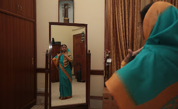 Photo: President Pratibha Patil looking at herslf in a traditional mirror in her dressing room. Indian Express photo